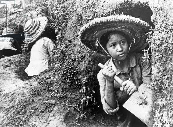 VIETNAM, 1966 Teenage girls digging hillside shelters in Hanoi, North Vietnam. Photograph, 1966.