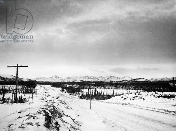 ALASKA: ALCAN HIGHWAY A stretch of the Alaskan Highway 77 miles south of Northway, Alaska, c.1955.