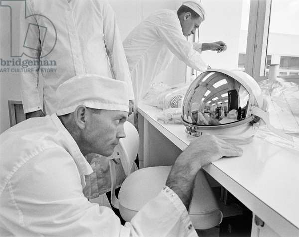 MICHAEL COLLINS (1930- ) American astronaut. Photographed in the White Room prior to entering the Gemini 10 spacecraft, July 1966.