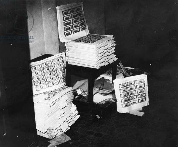 COUNTERFEIT MONEY, 1947 Twenty-one million dollars in conterfeit money seized in Marseilles, 1947.
