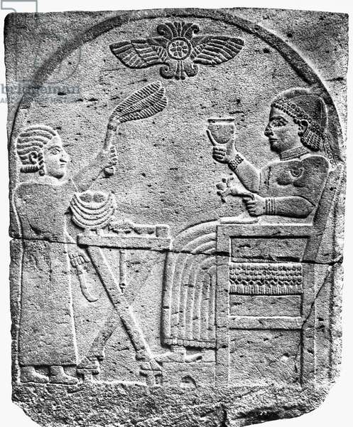 HITTITE EMPIRE: TOMB STELE Tomb stele of an Aramaean princess with her attendant, between them a table with a funeral meal. From Sam'al. Basalt, 8th century B.C.