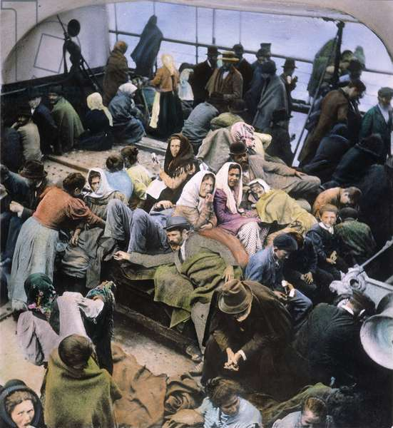 EUROPEAN IMMIGRANTS, 1902 European immigrants on the deck of a ship arriving at New York Harbor, 1902. Oil over a photograph.