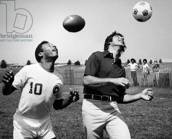 JOE NAMATH (1943- ) American football player. Publicity photograph, c.1975, with star soccer player Pelé (on left).