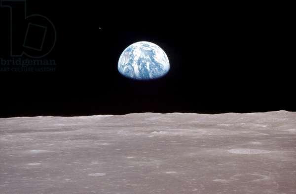 APOLLO 11: EARTH, 1969 View of Earth rising over Moon's horizon, taken from the Apollo 11 spacecraft. Photograph, 1969.