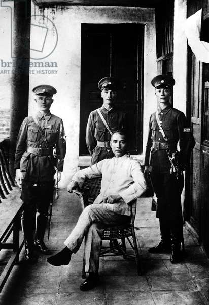 SUN YAT-SEN (1866-1925). Chinese political leader. Sun (seated), with a young Chiang Kai-Shek, whom he has just appointed as Commandant of the Whampoa Military Academy, standing directly behind him. Photographed c.1924.
