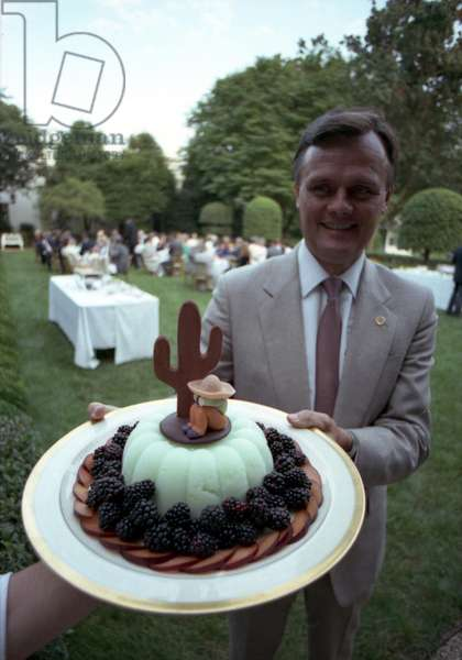 GARY WALTERS (1946- ) White House chief usher, 1986-2007. Holding a dessert for a dinner in First Lady Barbara Bush's East Garden. Photograph, 8 August 1989.