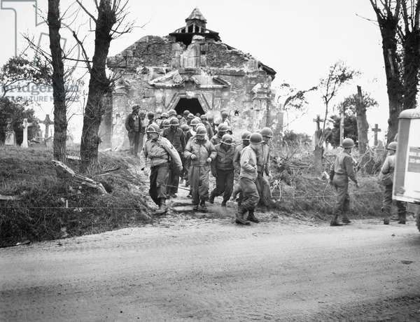 WORLD WAR II: D-DAY, 1944 American soldiers, sailors, and Coast Guardsmen leaving a ruined chapel near Omaha Beach after services the first Sunday after D-Day during World War II, 1944.