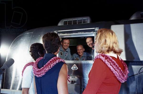 APOLLO 11: QUARANTINE, 1969 Astronauts Neil Armstrong, Edwin 'Buzz' Aldrin and Michael Collins, under quarantine, greeting their wives at Ellington Air Force Base in Houston, Texas. Photograph, 1969.