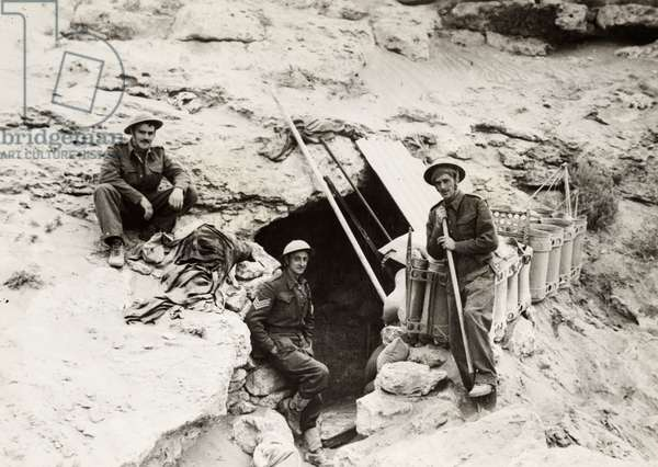 WWII: LIBYA, c.1941 British or South African soldiers outside of a bunker in the desert near Tobruk, Libya. Photograph, c.1941.
