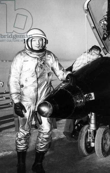 NEIL ARMSTRONG (1930-2012) American astronaut. Photographed with a North American X-15 aircraft after a test flight, 1960.