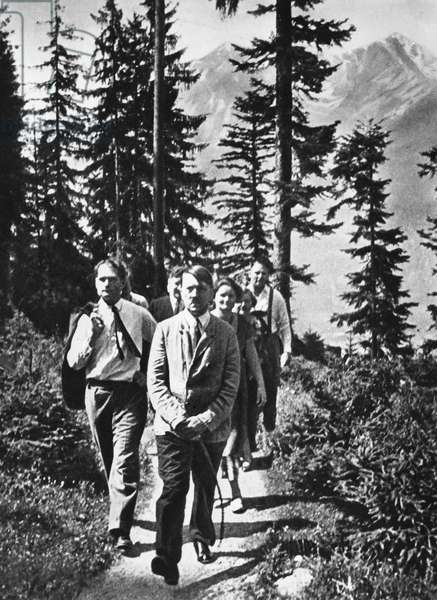 ADOLF HITLER (1889-1945) Chancellor of Germany, 1933-45. Hitler at Berchtesgarden, his retreat in the Bavarian Alps, with Rudolf Hess (Left) and others, August 1940.