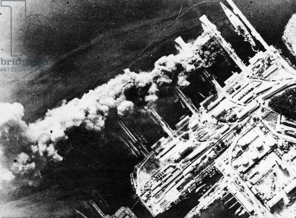 WORLD WAR II: FRENCH FLEET Aerial view of burning battleships of the French fleet at the harbor Toulon, France, scuttled by the Vichy government after German occupation of the southern zone of France, 27 November 1942.