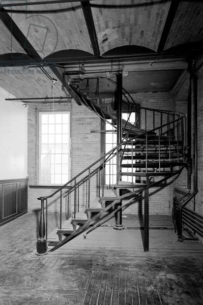 COLT FACTORY, 2005 Colt Firearms Company, stairway off the entrance of the east armory building (paneling to the left added in 1995), Hartford, Connecticut. Photograph by Jet Lowe, 2005.