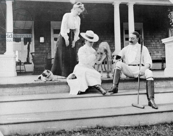 JOHN DREW (1853-1927) American actor. Photographed with his wife and daughter at their East Hampton, Long Island, New York, 'cottage', 1902.
