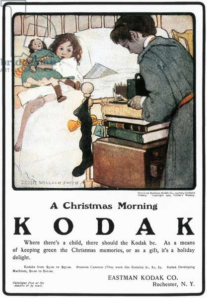KODAK ADVERTISEMENT, 1904 'A Christmas Morning.' Advertisement for a Kodak hand-held camera, from an American magazine, 1904.
