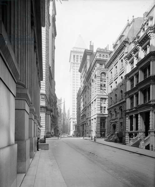 NYC: WALL STREET, c.1910 A view down Wall Street in New York City. Photograph, c.1910.