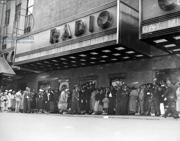 NEW YORK: RADIO CITY, 1935 Crowds outside Radio City Music Hall, New York City, waiting to see the motion picture 'Top Hat,' starring Fred Astaire and Ginger Rogers, 1935.