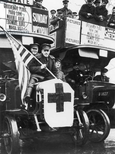 WORLD WAR I: ARMISTICE DAY Newly released prisoners of war celebrate the armistice by riding on buses run by the American Red Cross for servicemen visiting London, November 1918.