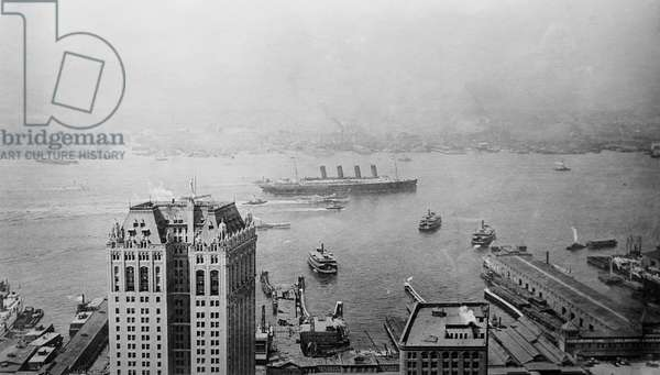 NEW YORK: LUSITANIA, 1908 The Cunard steamship 'Lusitania' at New York Harbor, seen from the Singer Building, 1908.