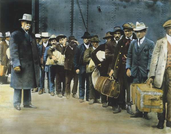 ITALIAN IMMIGRANT MEN Newly landed immigrants from the 'S.S. Princess Irene' on their way to Ellis Island. Oil over a photograph, c.1900.