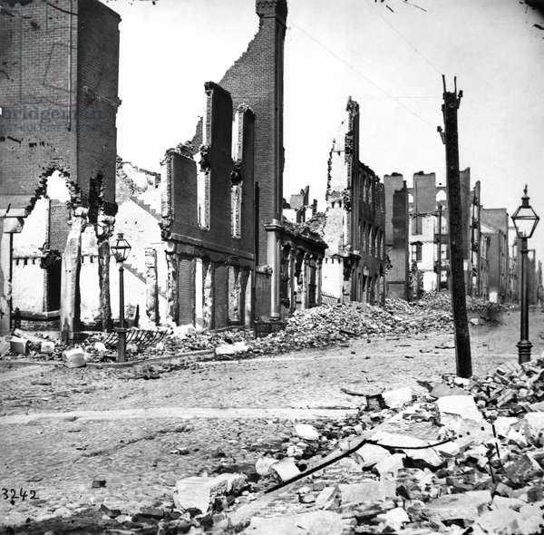 CIVIL WAR: RICHMOND, 1865. A street in ruins at Richmond, Virginia following the American Civil War. Photograph, April 1865.