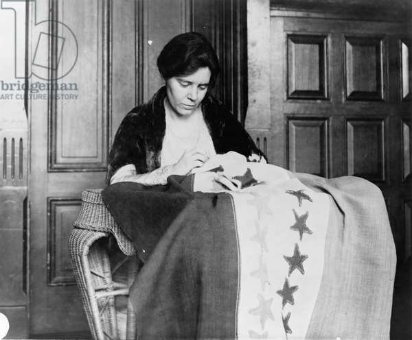 ALICE PAUL (1885-1977) American social reformer and founder of the National Woman's Party. Photographed while sewing a suffrage flag, c.1912-1920.