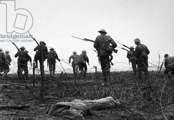 WORLD WAR I: BARBED WIRE Allied troops advancing through barbed wire during the Battle of the Somme, 1916.