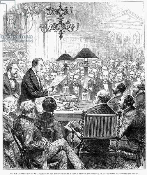 HEINRICH SCHLIEMANN (1822-1890). German traveler and archeologist. Schliemann addressing a scientific group in London, England. Wood engraving from an English newspaper of 1877.