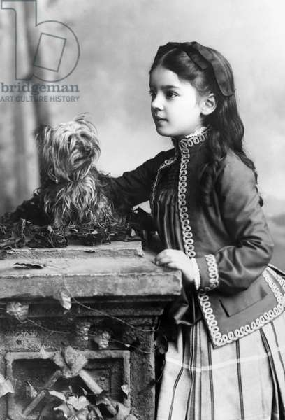MARIAN HUBBARD BELL (1880-1962) Marian Hubbard 'Daisy' Bell, daughter of the inventor, Alexander Graham Bell. Photographed with her dog in 1888 at age 8.