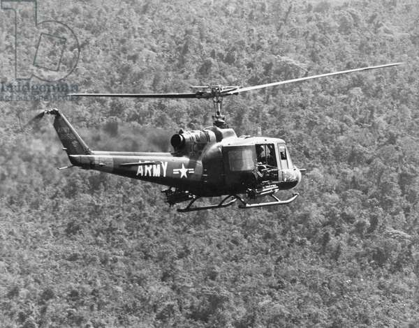 VIETNAM WAR: HELICOPTER A U.S. Army UH-1B helicopter in flight over South Vietnam, mid-1960s.