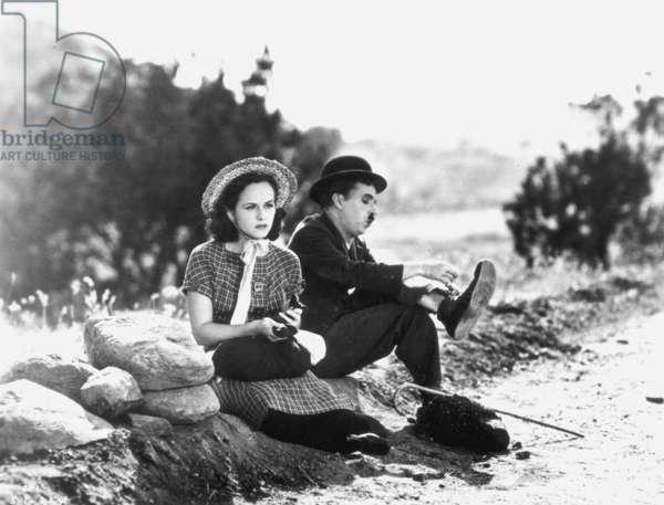"MODERN TIMES, 1936 Charlie Chaplin (1889-1977) and Paulette Goddard (1911-1990) in ""Modern Times"", 1936."