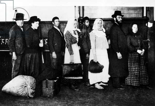 ELLIS ISLAND: IMMIGRANTS Group of newly arrived immigrants at Ellis Island, New York City. Photograph, late 19th or early 20th century.