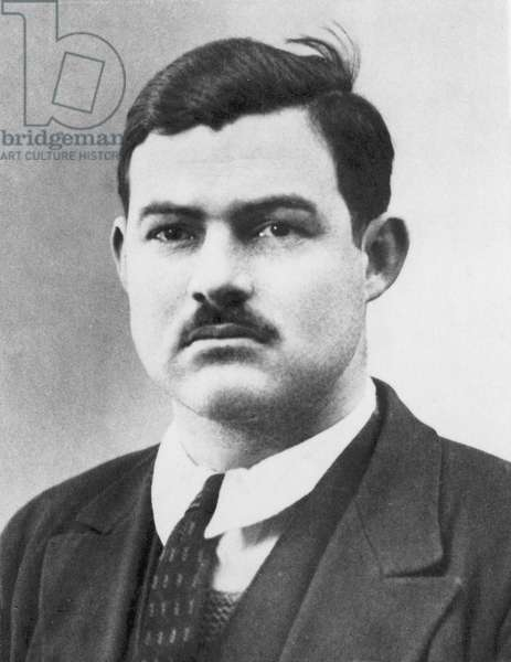 ERNEST HEMINGWAY (1899-1961). American writer. Photographed in Paris, 1924.