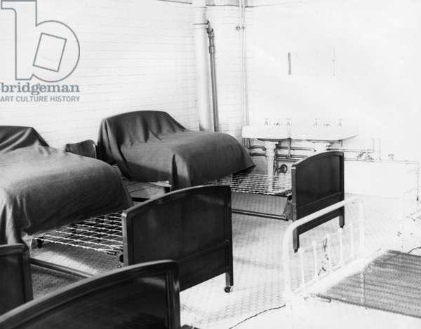 ELLIS ISLAND, c.1943 Sleeping quarters for female 'enemy aliens' detained on Ellis Island during World War II. Photograph, c.1943.