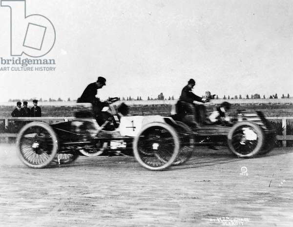 HENRY FORD (1863-1947) American automobile manufacturer. Automobile race between Ford and Alexander Winston in Grosse Pointe, Michigan. Photograph by W.D. Benham, 1901.