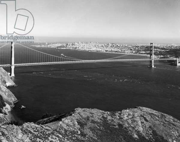 GOLDEN GATE BRIDGE The Golden Gate Bridge, completed in 1937, at San Francisco, California. Photograph, c.1975.