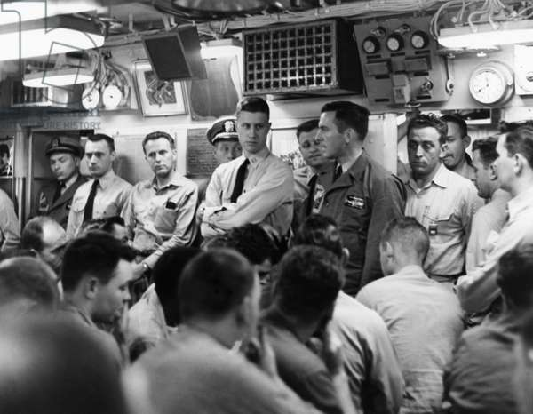 NAVY: USS NAUTILUS, 1958 Executive officer F.M. Adams addressing crew members of the USS Nautilus prior to arriving at the North Pole. Photograph, 1958.