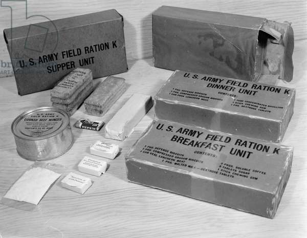 K RATIONS, 1943 K rations, highly concentrated emergency field rations used by the U.S. Army. Photograph by Howard Hollem, March 1943.