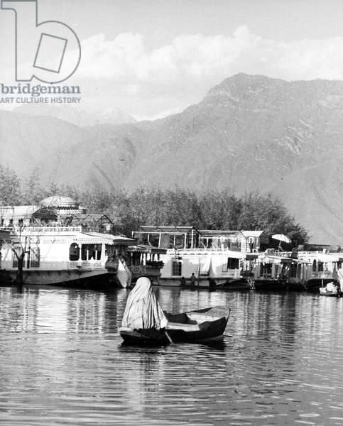 INDIA: KASHMIR, 1962 Dugas (houseboats) on the Dal Lake in Srinagarh, India. Photograph, 1962.