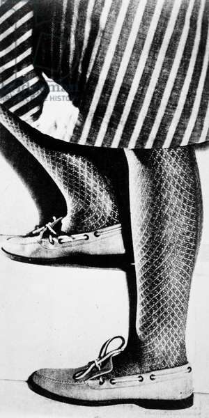 WORLD WAR II: STOCKINGS Nylon stockings, introduced in 1940, were scarse during the war, and American woman often wore cotton stockings. Fashion photograph, c.1943.