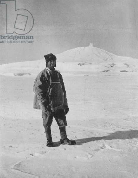 ROBERT FALCON SCOTT (1868-1912). English Antarctic explorer. Captain Scott, in the Antarctic with Mount Erebus in the background, on his 1910-1912 'Terra Nova' expedition. Photograph by Herbert Ponting.
