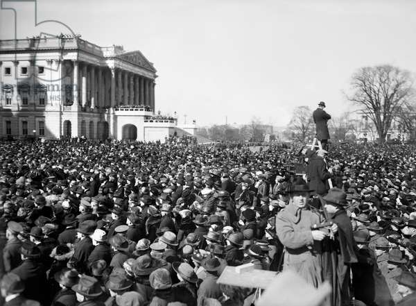 HARDING INAUGURATION, 1921 Crowds outside the Capitol in Washington, D.C., attending the inauguration of Warren G. Harding as 29th President of the United States, 4 March 1921.