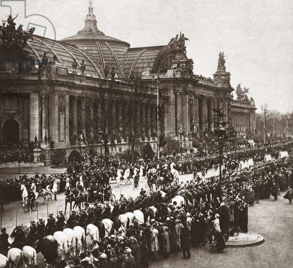 WORLD WAR I: PARIS, 1918 French Lancers saluting President Wilson as he drives through Paris, France. Photograph, 1918.