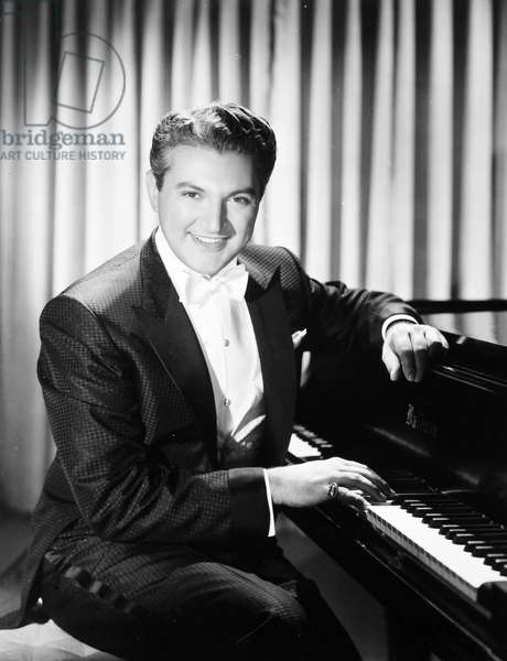 LIBERACE (1919-1987) Wladziu Valentino Liberace. American entertainer. In a still from the 1955 film 'Sincerely Yours.'