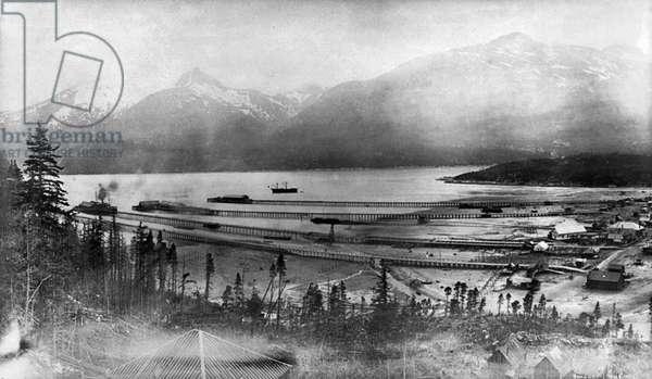 ALASKA: SKAGWAY, 1899 View of the piers on the Taiya Inlet at Skagway, Alaska, 1899.