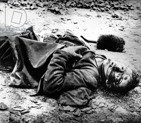 CIVIL WAR: DEAD SOLDIER A dead soldier with a cannon ramrod next to him. Photographed during the American Civil War, c.1863.