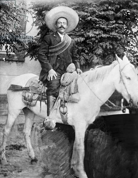 FRANCISCO 'PANCHO' VILLA (1878-1923). Mexican revolutionary leader. Photographed wearing bandoliers mounted on a horse. Photograph, c.1908-1919.