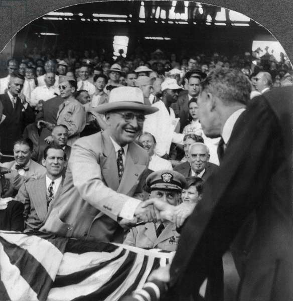 HARRY S. TRUMAN (1884-1972) 33rd President of the United States. Truman in a crowd of people, shaking hands with a man. Stereograph, c.1945.
