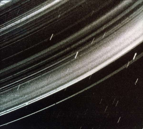 URANUS: RINGS Rings of Uranus, with backlit dust particles, photographed by NASA's Voyager 2 spacecraft, c.1986.