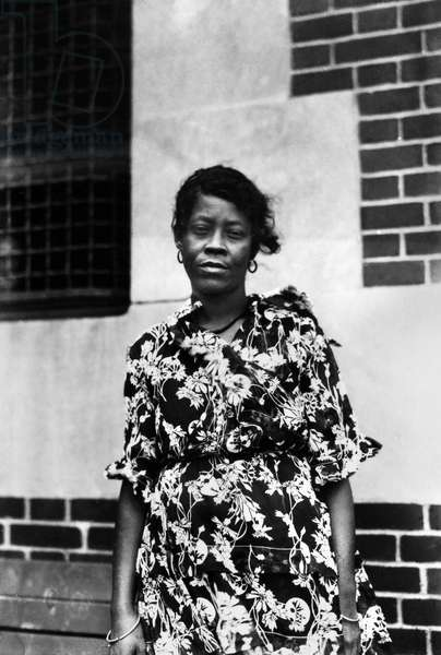 ELLIS ISLAND: WOMAN, 1920 Immigrant from French Guinea, photographed at Ellis Island, New York City, 1920.